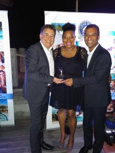 Flemming Friisdahl accepting the Top Growing Agency in Canada award from the team at Sandals